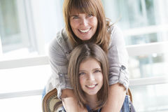 Happy mother and daughter. Smiling looking at camera Royalty Free Stock Images