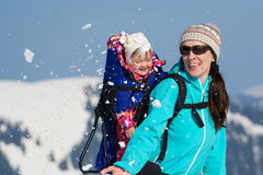 Happy mother and daughter in snow stock photos