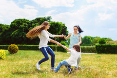 Happy Mother with daughter and son playing on Stock Photos
