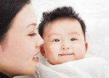 Happy Mother and daughter or son  smiling together Stock Photography