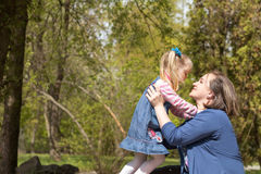 Happy mother and daughter in spring park Stock Images
