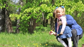 Happy mother and daughter in spring park stock footage