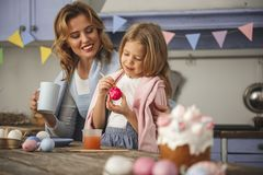 Cheerful family getting ready for easter Royalty Free Stock Images