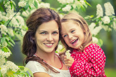 Happy mother and daughter in summer park Royalty Free Stock Images