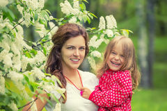 Happy mother and daughter in summer park Royalty Free Stock Image