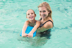 Happy mother and daughter in the swimming pool Royalty Free Stock Photo
