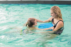 Happy mother and daughter in the swimming pool Stock Image