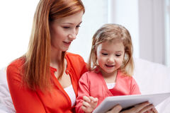 Happy mother and daughter with tablet pc computer Royalty Free Stock Photography