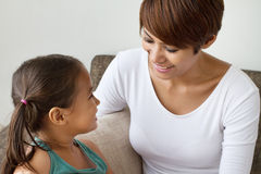 Happy mother and daughter talking Stock Images