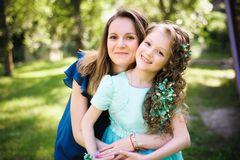 Happy mother and daughter together outdoors in a park stock photos