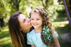 Happy mother and daughter together outdoors in a park royalty free stock photo