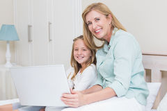 Happy mother and daughter using laptop Royalty Free Stock Images