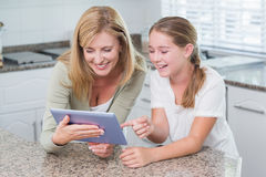 Happy mother and daughter using tablet pc together Royalty Free Stock Images