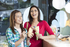 Happy Mother And Daughter With Vanilla Ice Creams Stock Image