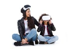 happy mother and daughter in virtual reality headsets sitting on floor royalty free stock photography