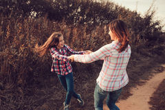 Happy mother and daughter on the walk on summer field. Family spending vacation outdoor Stock Photo