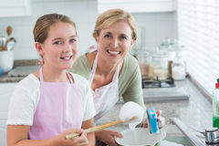 Happy mother and daughter washing up together Royalty Free Stock Photography