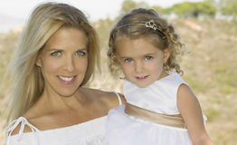 Happy Mother and Daughter in White Stock Images