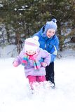 Happy mother and daughter in a winter park Royalty Free Stock Photos