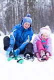 Happy mother and daughter in a winter park Royalty Free Stock Photo