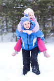 Happy mother and daughter in a winter park. Happy mother and daughter, the family for a walk in a winter park, luge, skiing, skating, snowballs Stock Photos