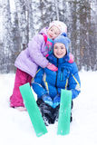 Happy mother and daughter in a winter park Stock Photography