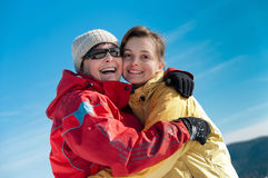 Happy mother and daughter in winter Stock Photo