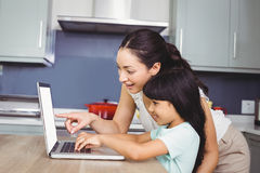 Happy mother and daughter working on laptop Royalty Free Stock Image