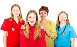 Happy mother with daughter and the young female doctors. Photo of happy mother with daughter and the young female doctors Royalty Free Stock Photo