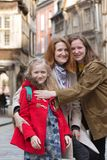 Happy mother and daughters. In the famous city of Dinan. Normandy, France stock photos