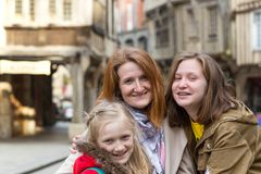 Happy mother and daughters. In the famous city of Dinan. Normandy, France royalty free stock image