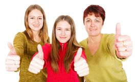 Happy mother with daughters. Photo of happy mother with daughters showing thumbs up Stock Image