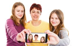 Happy mother with daughters. Self portrait photo of happy mother with daughters Royalty Free Stock Photography