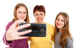 Happy mother with daughters. Self portrait photo of happy mother with daughters Stock Photos