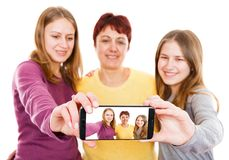 Happy mother with daughters. Self portrait photo of happy mother with daughters Royalty Free Stock Image