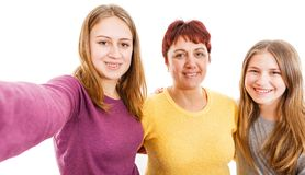 Happy mother with daughters. Self portrait photo of happy mother with daughters Stock Image
