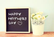Happy mother day written on chalkboard,