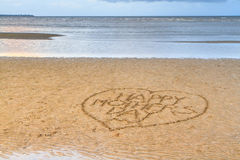 Happy Mother's Day written in the sand Stock Photos