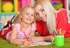 Mother draws with her little daughter Royalty Free Stock Image
