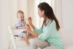 Happy mother eating with her baby boy Royalty Free Stock Photography