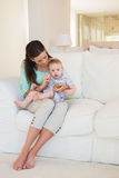 Happy mother eating with her baby boy Stock Photo