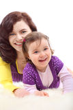 Happy mother embraces her laughing daughter royalty free stock photography