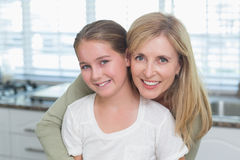 Happy mother embracing her daughter Stock Photography