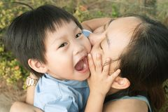 Happy mother embracing and kissing her son : Closeup. Happy asian mother embracing and kissing her son : Close up Stock Photos