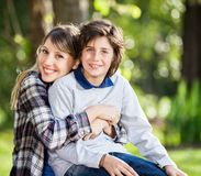 Happy Mother Embracing Son At Campsite Stock Photo