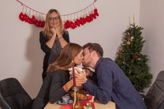 A Happy Family at Christmas. Happy mother at the engagement party of her daughter at Christmas Stock Image