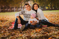 Happy mother, father and daughter in the park Royalty Free Stock Image