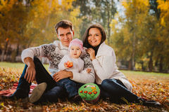 Happy mother, father and daughter in the park Royalty Free Stock Photo