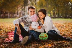 Happy mother, father and daughter in the park Royalty Free Stock Photos