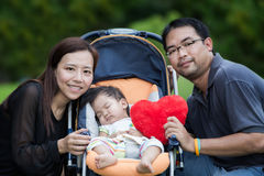 Happy mother, father and daughter in the park Stock Photography